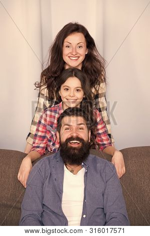 Mom Dad And Daughter Relaxing On Couch. Happy Parenthood. Close And Trustful Relations. Family Value