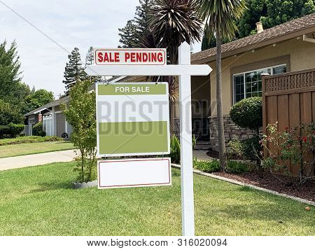 A Sale Pending Sign On A House For Sale In A Nice Residential Neighborhood In Silicon Valley.