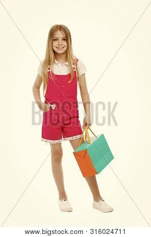 Kids Designer Clothing Summer Sale. Girl Cute Teenager Carries Shopping Bag. Kid Bought Clothing Sum