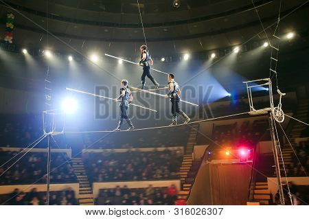 The Tightrope Walkers At The Circus Arena.