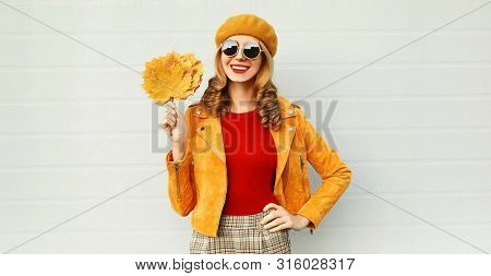 Autumn Portrait Smiling Woman Holding Yellow Maple Leaves Wearing French Beret Posing On City Street