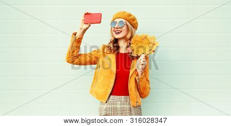 Autumn Smiling Woman Taking Selfie Picture By Phone Holding Yellow Maple Leaves Wearing French Beret