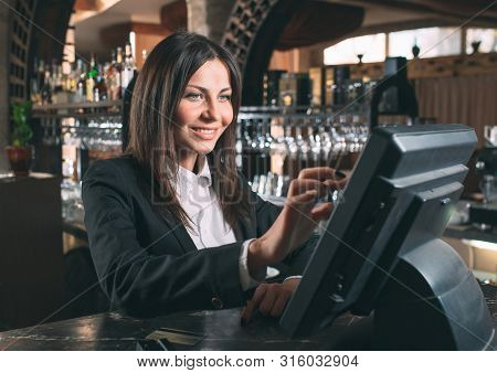Small Business, People And Service Concept - Happy Woman Or Waiter Or Manager In Apron At Counter Wi