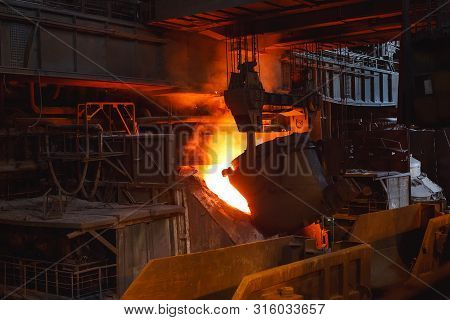 smelting of the metal in the foundry, Factory worker takes a sample for metal. poster