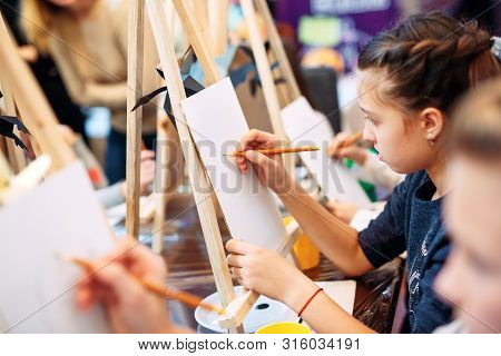 Group Lesson In Drawing. Children Learn To Draw In The Classroom