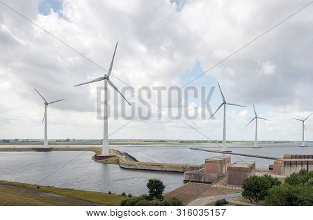 Krammer Wind Farm And Western Entrance Krammer Lock Complex Between The Fresh Water Of The Volkerak