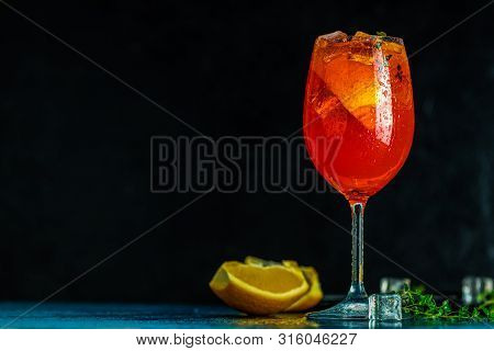 Cocktail Aperol Spritz In Big Wine Glass With Water Drops On Dark Background. Summer Alcohol Cocktai