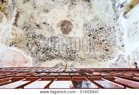 Ancient painted plaster on the ceiling of one of the caves in Little Petra Jordan poster