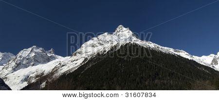 Panorama Caucasus Mountains. Region Dombay. Sofrudzhu Belalakaya. poster