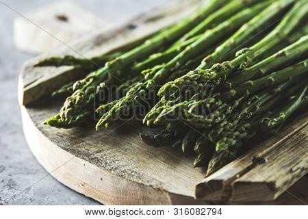 Tasty Asparagus On A Sliced Old Board. Vintage Style A