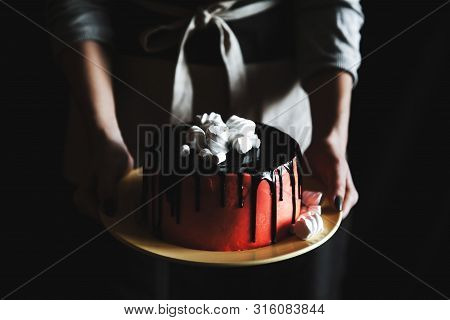 Woman Holding Cake With Marshmallow On Black Background A
