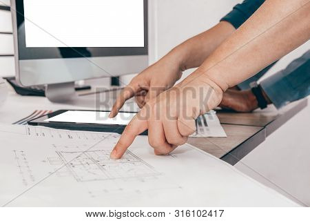 Architect Interior Designer Working With House Drawing Plan & Color Swatch