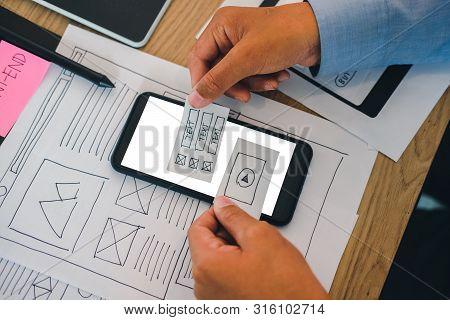 User Experience Ux Designer Designing Web On Smart Phone Layout. Ui Developer Planning Working On Mo