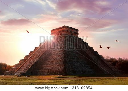 Archaeological Complex Chichen Itza. Mayan Pyramid On The Background Of A Beautiful Sunset. Temple O