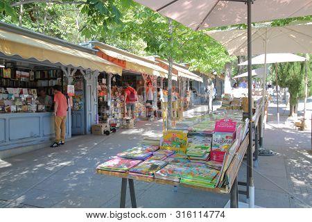 Madrid Spain - May 28, 2019: Unidentified People Visit Book Street Market Shop In Madrid Spain