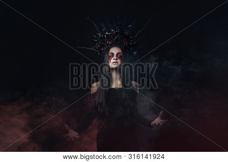 Terrible Horror Halloween Vampire Woman Portrait. Beauty Vampire Witch Lady With Blood On Mouth Posi