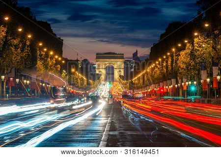 Night Scence Illuminations Traffic Street Of The Impressive Arc De Triomphe Paris Along The Famous T