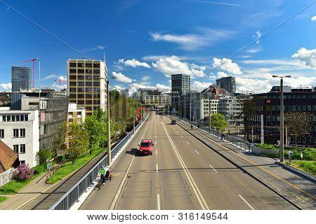 Basel, Switzerland - April 17, 2019. View From The Pedestrian Bridge To The Modern Neighborhood Of B
