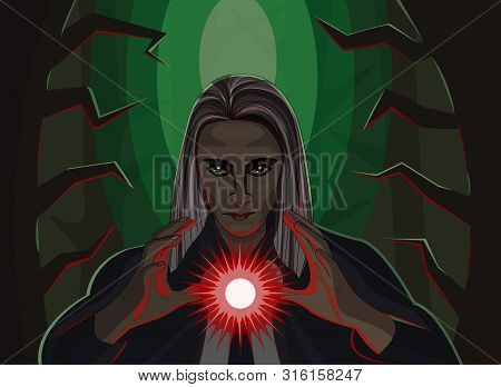 The Wizard In The Forest Holds A Magic Red Ball In The Dark Forest