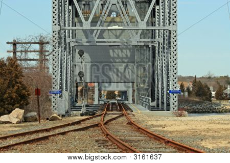 A shot straight across the Cape Cod Railroad Bridge near Bourne Massachusetts. poster