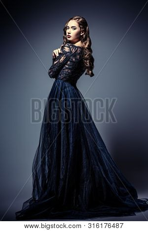 A full length portrait of a beautiful brunette lady. Evening dress. Fashion, beauty.