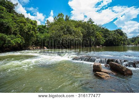 Mountain River With Stones. Fast Water Current. Water Photo Texture. Grey River In Tropics Wallpaper