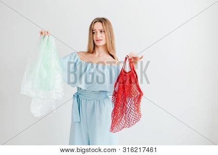 Girl Compares A Useful String Bag And Harmful Plastic Bags