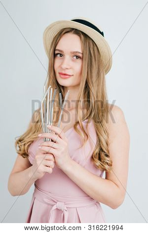 Girl Holds In Hands Reusable Metal Drinking Straws For Cocktails