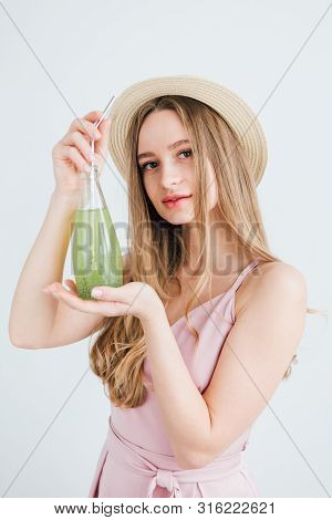 Girl Drinks A Healthy Green Drink With Basil Seeds