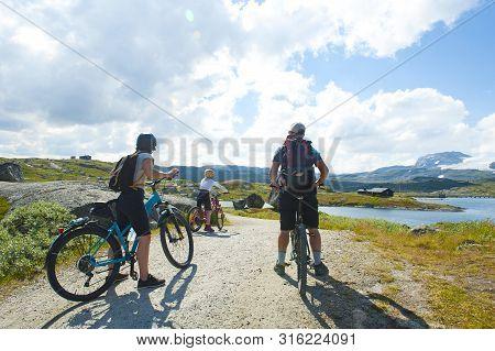 Finse, Norway - July 28, 2019: Tourists Biking In Finse