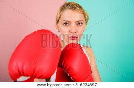 Boxing Improve Temper And Will. Concentrated On Punch. Woman Boxing Gloves Focused On Attack. Ambiti