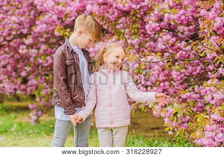Tender Love Feelings. Little Girl And Boy. Romantic Date In Park. Spring Time To Fall In Love. Kids