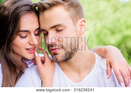 Attractive couple. Sexual attraction. Relaxing with darling. Lovers cuddling. Couple in love. Trust and intimacy. Sensual hug. Love romance concept. Romantic date. Handsome man pretty girl in love poster