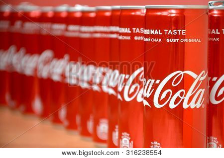 Coca-cola Logo Printed On Aluminium Cans And Placed On Shopping Mall Table