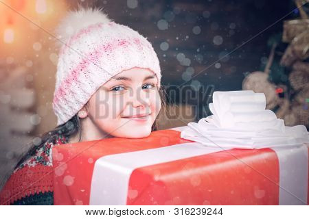 Teenager Hold Christmas Gift Box. Happy Little Girl With Christmas Gift Box. Cute Little Girl Near C