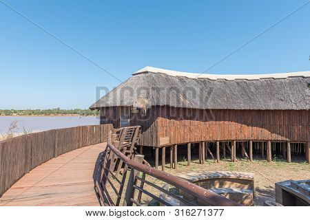 Kruger National Park, South Africa - May 9, 2019: A View Of The Sable Bird Hide. A Walkway And The S
