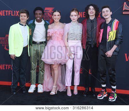 LOS ANGELES - JUN 28:  Gaten Matarazzo, Caleb McLaughlin, Millie Bobby Brown, Sadie Sink, Finn Wolfhard and Noah Schnapp arrives to Netflix 'Stranger Things' Season 3 Premiere June 28, 2019 in SM