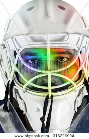Detail Of A Male Face In A White Goalie Hockey Mask.colorful Light In The Face.this Is A Detail Hock
