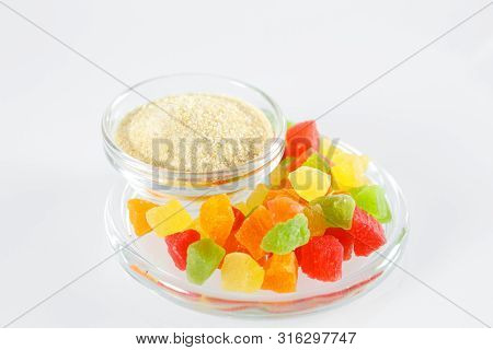 Gelatin and colorful jelly isolated on the white backgrounde. poster