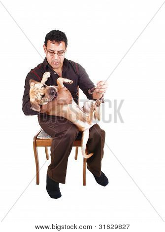 Man Playing With Dog.