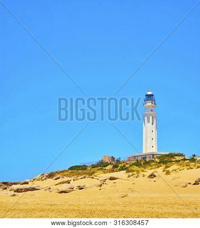 Trafalgar Lighthouse In The Cabo De Trafalgar Cape Natural Park. Barbate, Los Caños De Meca, Cadiz.