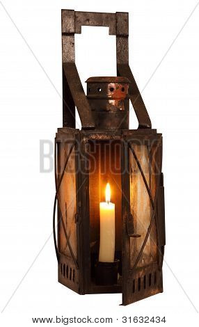 Old Lamp With Alight Candle Isolated On White