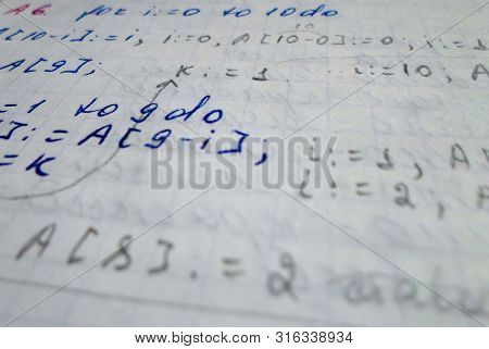 Pascal Program Written In A Notebook. Side View. The Work Of The Programmer And Sisadmida