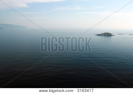 Landscape View Of An Island On A Blue Sea