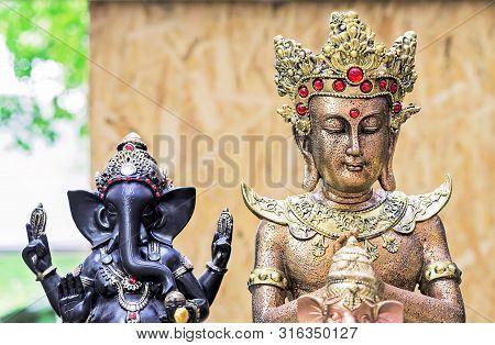 Buddha Statuette In A Street Souvenir Shop. Indian Souvenir Statuettes And Handicrafts.