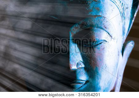 Buddha Face Close-up. Spiritual Enlightenment. Zen Buddhism. Traditional Thai Statue With Ethereal L