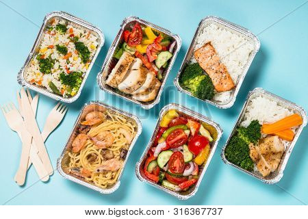 Food Delivery. Different Aluminium Containers With Healthy Diet Natural Food. Top View On Blue Backg