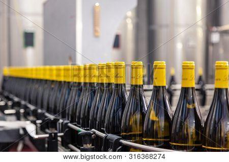 France Lyon 2019-06-20 Wine Production Line, Olivier Leflaive Bottles On Automatic Conveyor Tape Ove