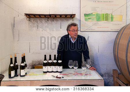 France Lyon 2019-06-20 Adult Man Professional Sommelier Taster, Winery Staff Make Tasting Line Top L