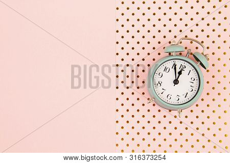 Flat Lay With Vintage Alarm Clock Over The Bastel Background